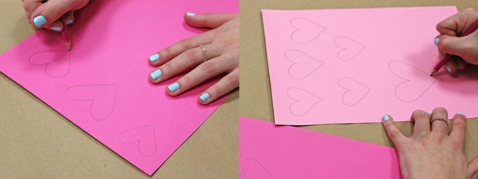 drawing hearts on pink paper