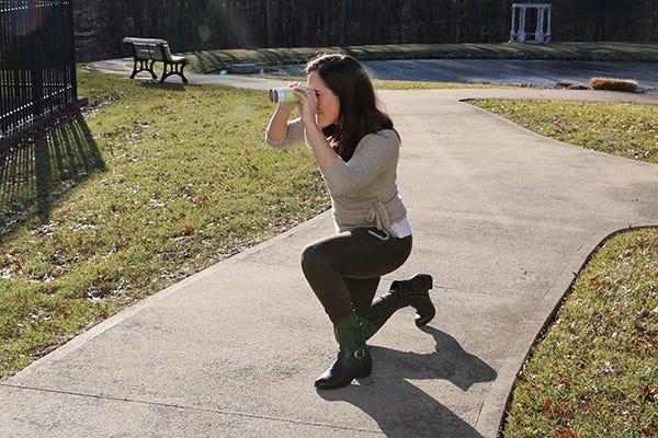 person looking through binoculars