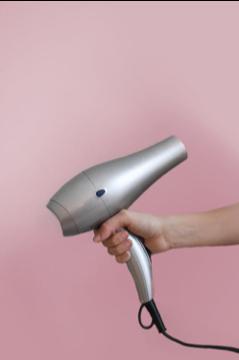 blow dryer in hand